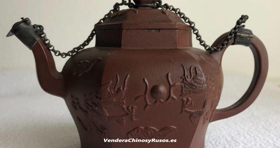 Tetera de terracota con dragones arte chinos